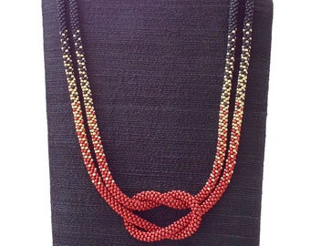Ombré Love Knot Kumihimo Necklace Tri Color Black, Red, Gold.  Give the gift of Love