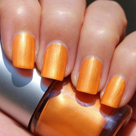 Sunet Franken Nail Polish - Bright orange color with gold shimmer