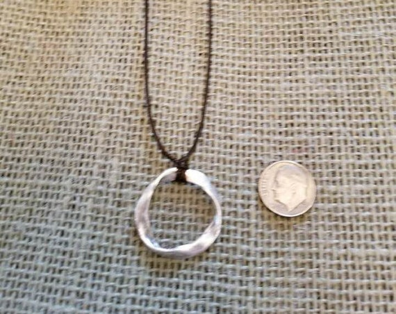 Necklace with a Silver Tone Ring Pendant