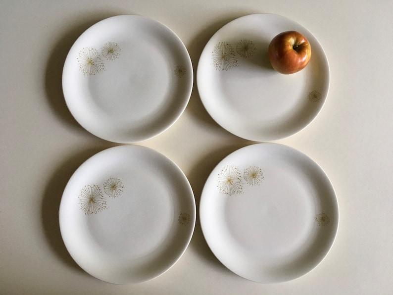 Raymor Universal Golden Burst Dinner Plates.