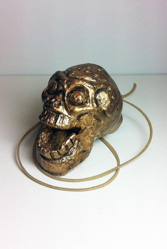 Aztec Death Whistle - the Golden Artifact - Aztec death whistle, aztec culture, screaming whistle, mayan death whistle.