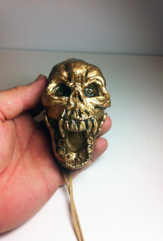 Aztec Death Whistle - The Skull in gold - You won't believe the horrific sounds of death and screams this whistle can produce.