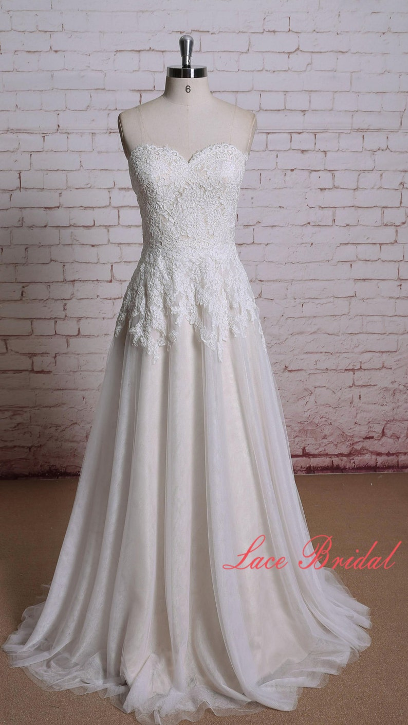 Wedding dress of Sweetheart Neckline Ivory Color Lace with image 0