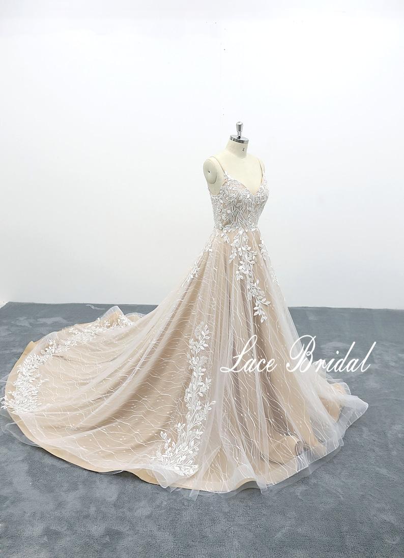 6b49f9d3da A-line wedding dress cathedral train bridal gown spaghetti