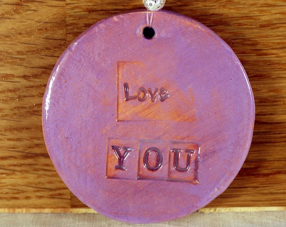 Love You Hanging Pottery Decoration, with nice lilac glaze and sent to you in a lovely white gossamer bag. Great for Mothers Day.
