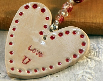 Love U Handmade Pottery Heart, hand painted with red and white glazes. Sent in a lovely gossamer bag to give as a gift.