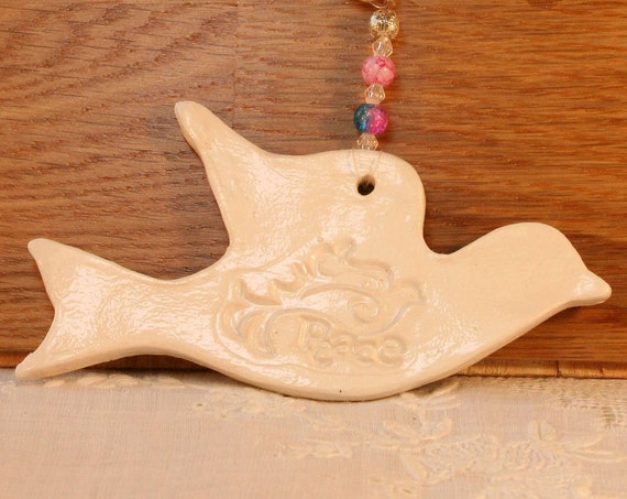 Pottery Peace Dove. Hand painted with a lovely white glaze. Sent to you in a white gossamer bag.