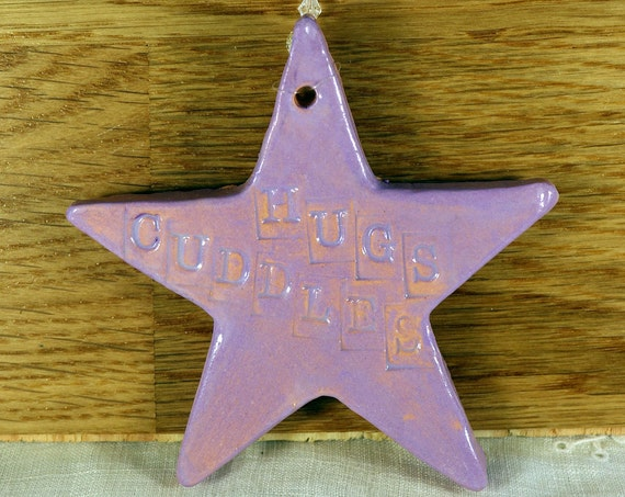 Hugs Cuddles Handmade Pottery Star, a lovely gift for a special someone. Which will arrive in a white gossamer bag.