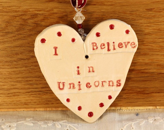 I Believe in Unicorns Pottery Heart, with red & white glazes. Handmade pottery sent in a lovely gossamer bag ready to be given as a gift.
