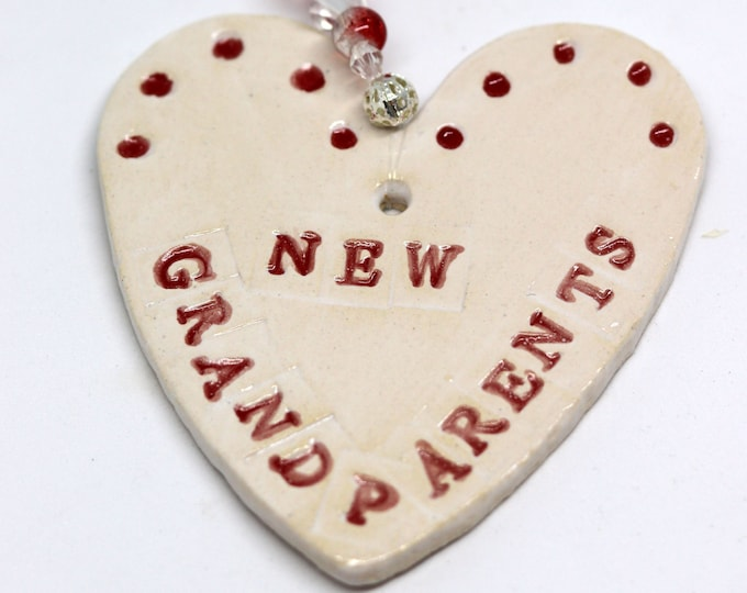 New Grandparents Handmade Pottery Heart, a lovely gift to celebrate the arrival of your new baby. Which will arrive in a white gossamer bag.
