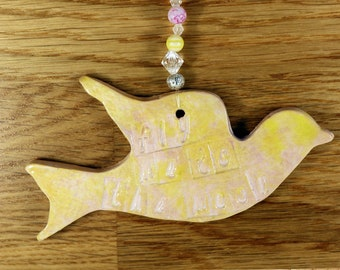 Flying Bird, Fly Me to the Moon, Hanging Decoration, with nice salmon pink glaze in a lovely white gossamer bag. Great for Mothers Day.