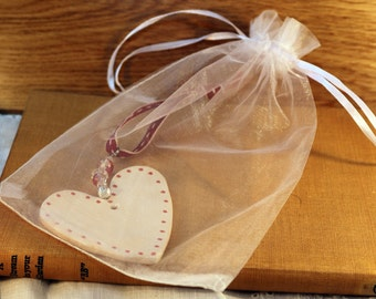 White and Red Spotty Handmade Pottery Heart, hand painted with red and white glazes. Sent in a lovely gossamer bag to give as a gift.