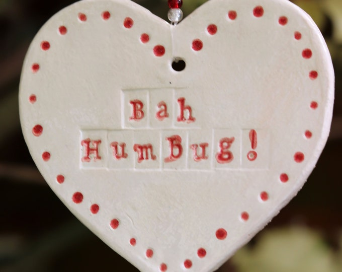 Featured listing image: Bah Humbug Clay Pottery Christmas Decorations, you can pick from two lovely handmade hearts. A great gift or stocking filler for Christmas.