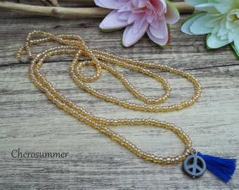 Cute boho necklace topaz colors with peace sign and tassel