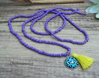 Cute boho necklace lavender color purple with leo pattern appendages and tassel hippie