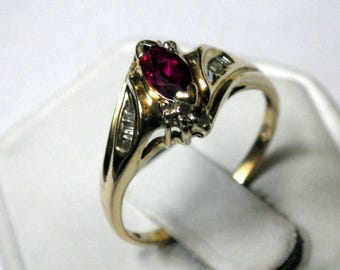 VINTAGE RUBY LADIES Ring with diamond accents mounted on solid cast 14K  yellow gold ring