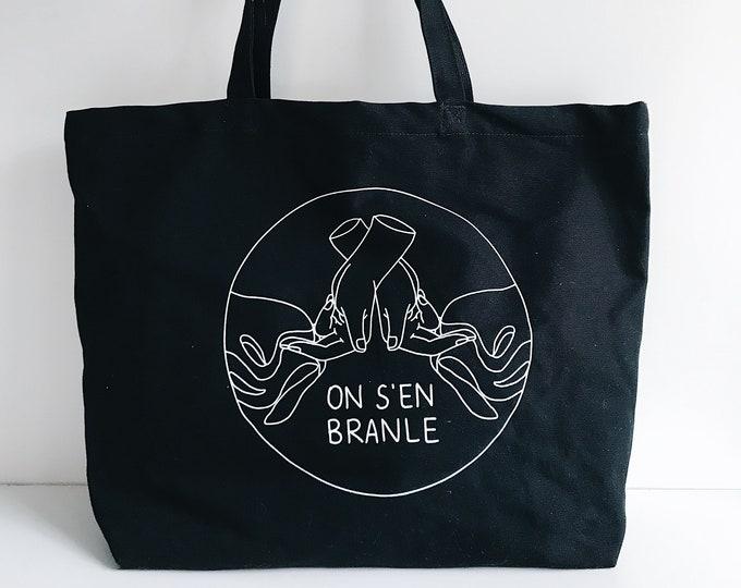 Image de l'article à la une: On s'en branle - Grand sac noir sérigraphié en coton bio