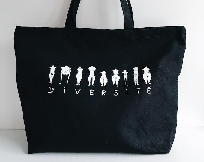 Image de l'article à la une: Diversité - Grand sac noir sérigraphié en coton bio