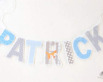 Grey and blue fabric name banner, personalised name banner, name wall hanging, name garland, name bunting, fabric letters on Baker's Twine