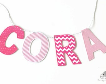 Pink fabric name hanging, pink name banner, pink name garland, hot pink name bunting, pink nursery décor, fabric letters on Baker's twine