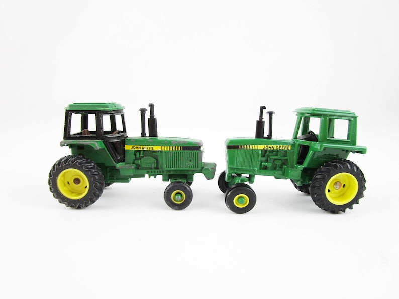 Two John Deere Miniature Tractors - 1:64 Scale - Metal Toy - Unmarked -  Ertl, Dyersville, Iowa - Collectible Farm