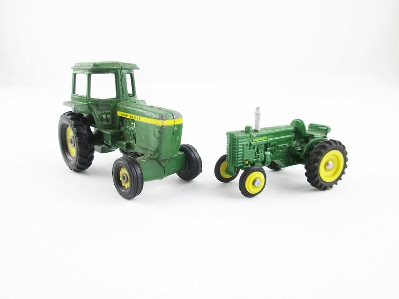 Metal Toy Tractors >> Two John Deere Miniatures 1 64 Scale Tractors Metal Toy Tractor And M Model Tractor Ertl Dyersville Iowa Collectible Farm