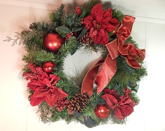 vintage red christmas wreath with pinecones and pointsettias
