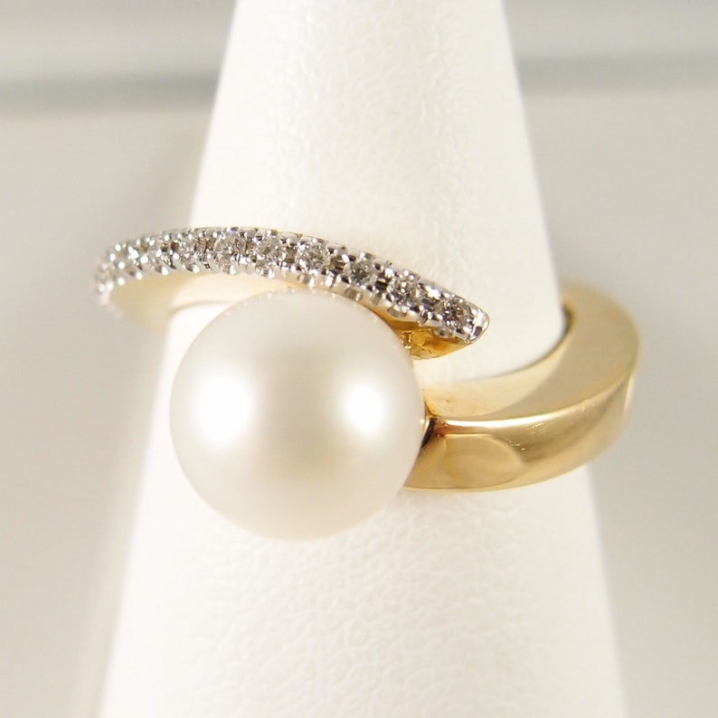 Elegant solid gold ring with premium cultured pearl and 16 image 0