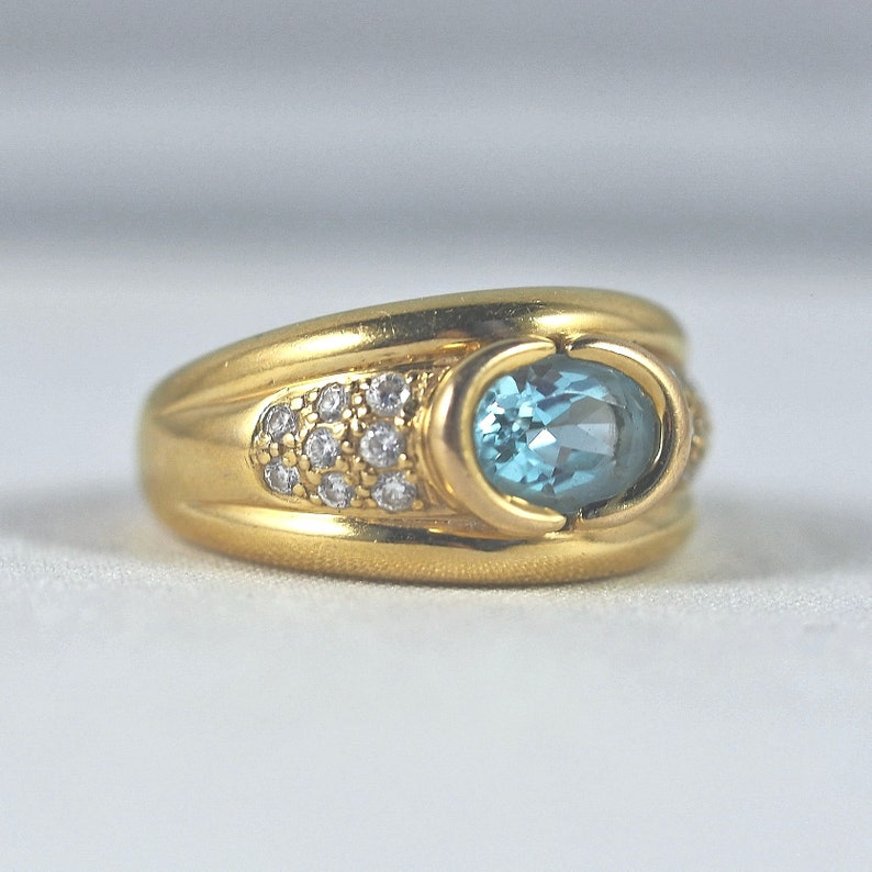 Massive solid gold ring with exquisite blue topaz Stamped fine image 0