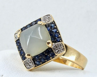Mesmerizing chalcedony sugarloaf cabochon gemstone crafted in 18K solid gold with natural sapphires and diamonds Stamped fine jewelry