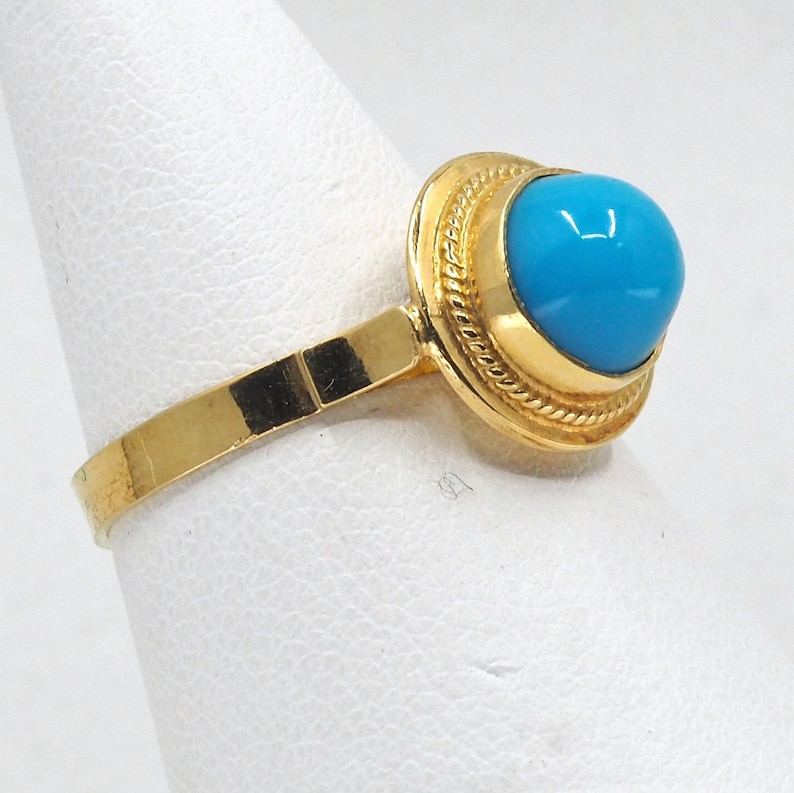 18K solid gold ring with a natural turquoise cabochon gemstone image 0