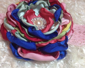 Satin petal flower with pearl center. Made to match matilda jane