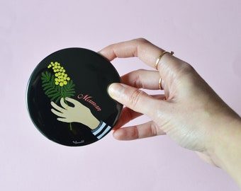Pocket mirror- Hand giving  Mimosa and its black and yellow pompoms cotton pocket. 2 Variations 1 drawing, 2 drawing + maman.