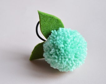 Hand made light green Pompom pony tail holder. Mint hair accessory for girls.