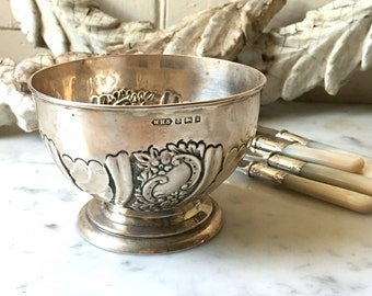 antique English sterling silver repoussé footed bowl, hallmarked 1909