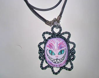Handmade polymer clay pendant with Cheshire cat from Alice in Wonderland