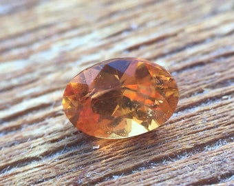 Spessartite Garnet Faceted Oval Natural Gem 0.57ct