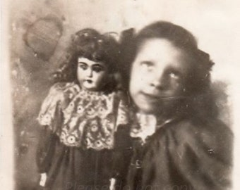 Victorian girl with her doll