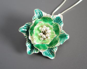 Green enamelled sterling silver hellebore flower necklace. Delicate nature statement pendant jewelry.