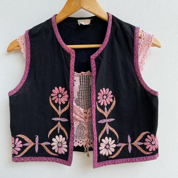 Indian cotton folk embroidered waist coat.
