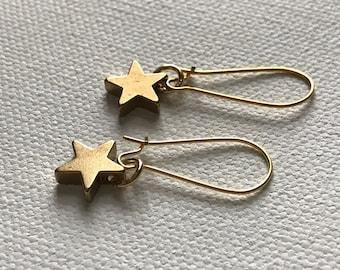 Gold star drop earrings