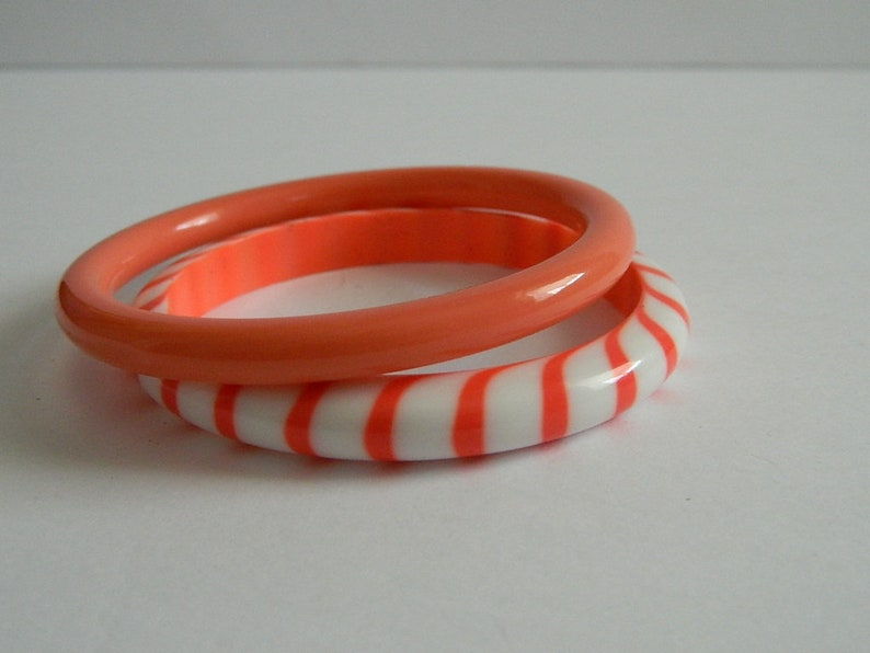 Pair of Retro 1970s Rounded Melon and White Plastic Bangles