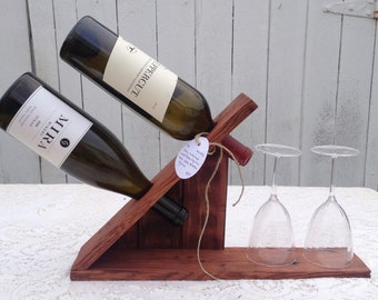 Tabletop Wine Rack holds two bottles of wine and two glasses