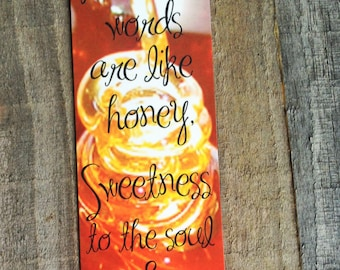 Warm honey bookmark featuring Proverbs 16:24