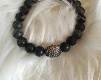 Black beaded bracelet with pave bead