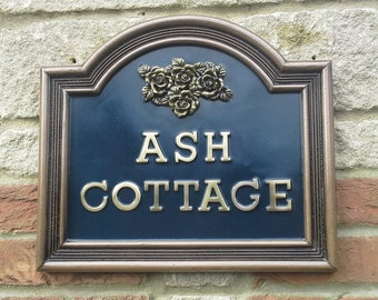 House Name Signs.Bronze and pewter finishes.Red, Black & Blue Backgrounds.Roses motif add 16 to 18 letters added in the name of your choice.
