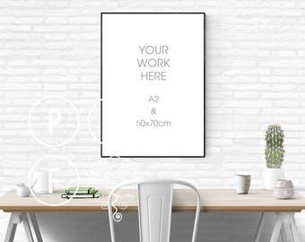 Download Free black poster frame mockup 50x70, A2 mockup, white brick wall, white subway tile, thin frame, styled stock photo, desk scene, cactus, green PSD Template
