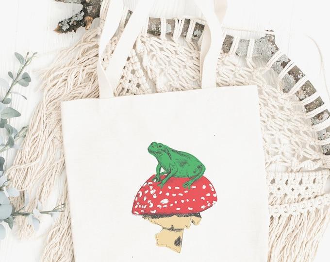 Featured listing image: Frog on Mushroom Tote Bag, Cottagecore Bag, Mushroom Bag, Frog Bag, Personalised Natural Cotton Tote Bag, Plant aesthetic, floral, hippy