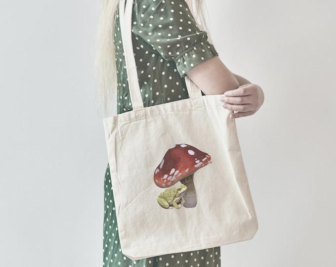 Featured listing image: Frog under Mushroom Tote Bag, Cottagecore Bag, Mushroom Bag, Frog Bag, Natural Cotton Tote Bag, Toadstool, Plant aesthetic, floral, hippy