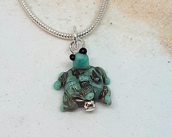 Tiny glass turtle necklace - shades of eggshell green